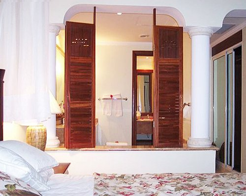 A well furnished bedroom with a bathroom.