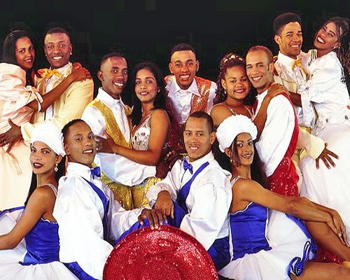 A group of people posing for the camera in the dance costume.
