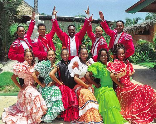 A group of people posing a flamenco dancing dress at the resort.