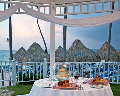 Covered outdoor dining area overlooking the beach.