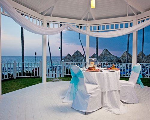A well furnished outdoor banquet hall alongside the beach.