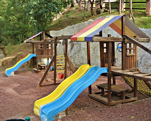 Outdoor picnic area with kids playscape.