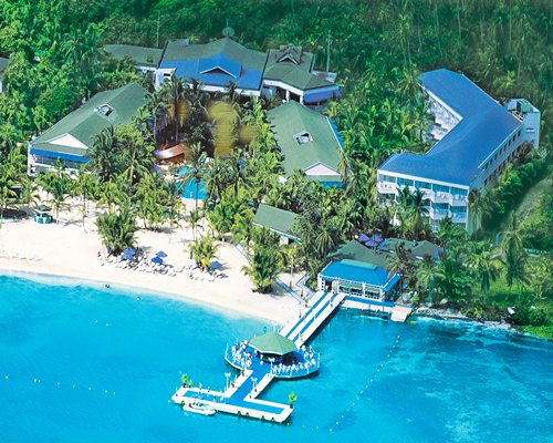 An aerial view of the resort properties alongside the beach.