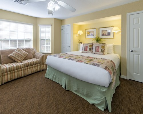 A well furnished bedroom with a king size bed and an outside view.