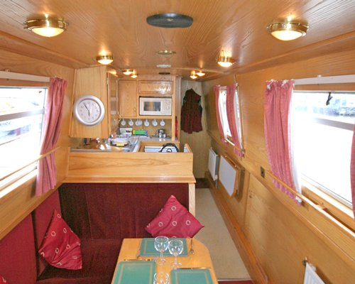A well furnished living area alongside the kitchen at the boat.