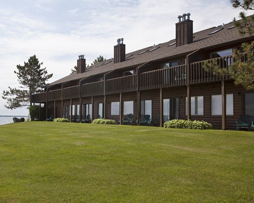 An exterior view of resort units alongside a manicured lawn.