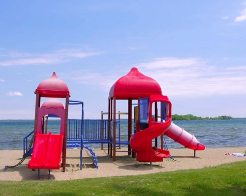 A view of an outdoor playscape alongside the lake.