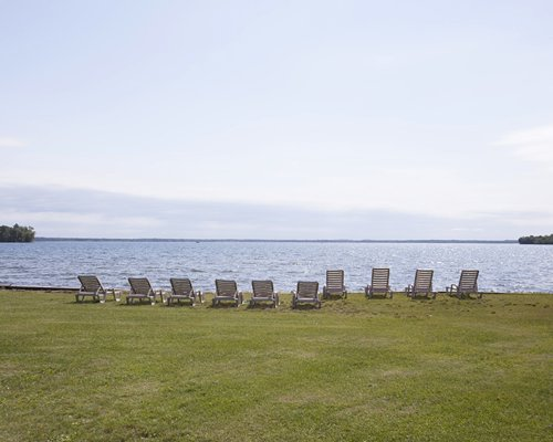 A view of chaise lounge chairs alongside the waterfront.