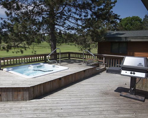 An outdoor hot tub with a barbecue grill.