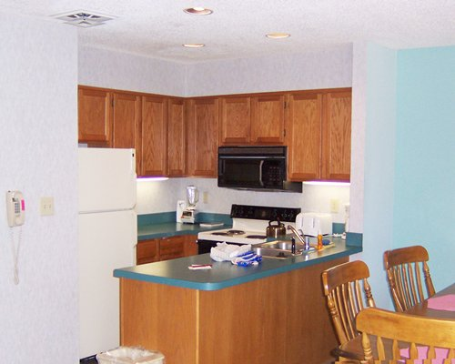 An open plan dining kitchen with a microwave oven.