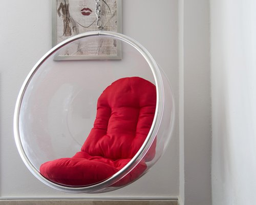 A hanging bubble chair.