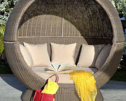 A view of an outdoor cocoon chair.