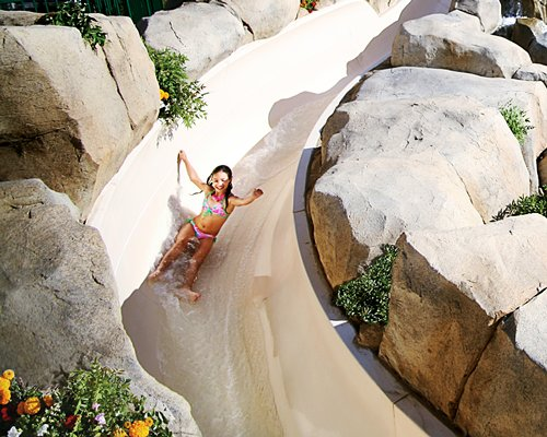 A view of kid playing in the water slide.