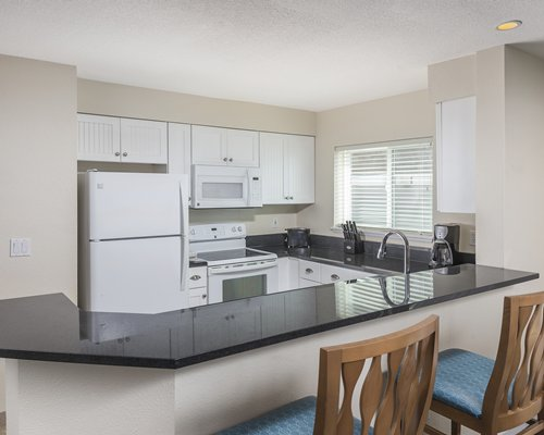 A well furnished kitchen with a breakfast bar.