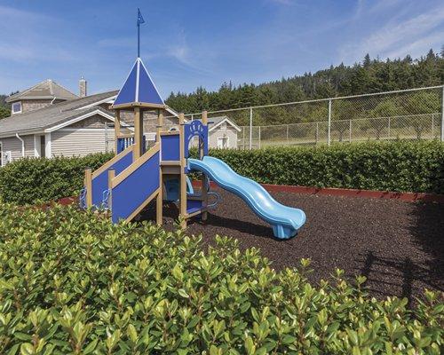 An outdoor play area alongside resort units.