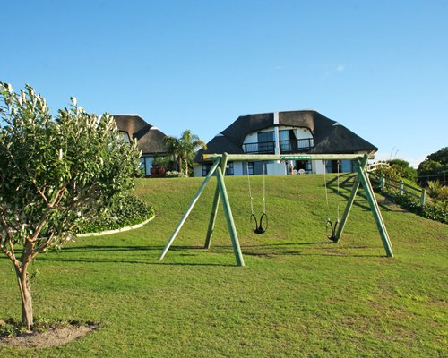 A view of an outdoor playscape with a swing.