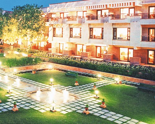 View of Jaypee Palace Hotel with landscaped picnic area and fountain.