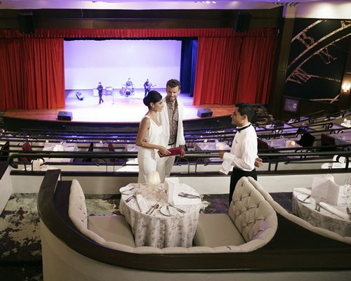 A couple at a dining theater with entertainment stage view.