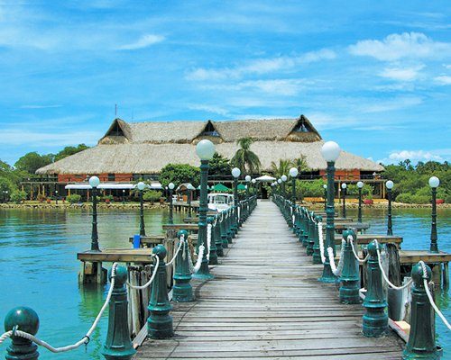 A view of wooden pier leading to the resort.
