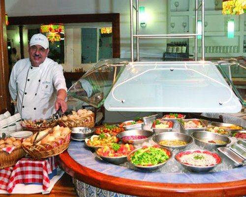 A well furnished indoor fine dining restaurant with a buffet.
