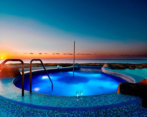 An outdoor hot tub at dusk.