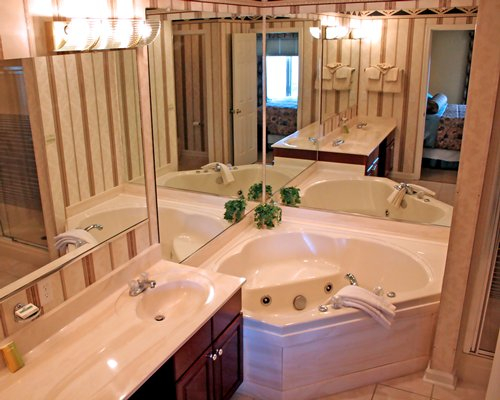A bathroom with a closed sink vanity and bathtub.
