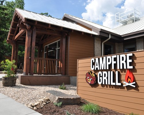 An exterior view of a resort unit with a Campfire Grill logo.