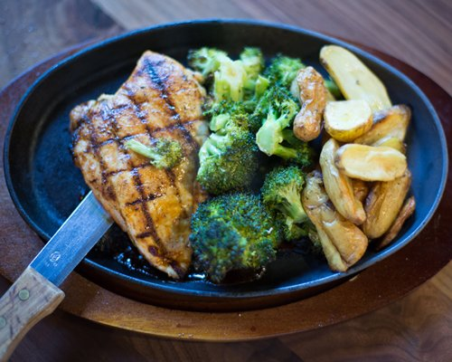 Grilled chicken broccoli and fried potatoes.