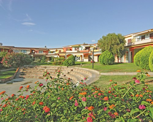 A scenic exterior view of the Residenza LOasi resort.