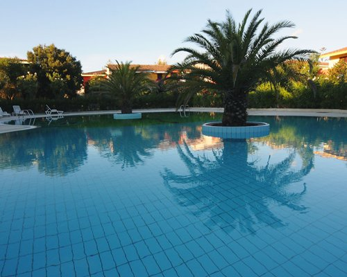 Large outdoor swimming pool with chaise lounge chairs.