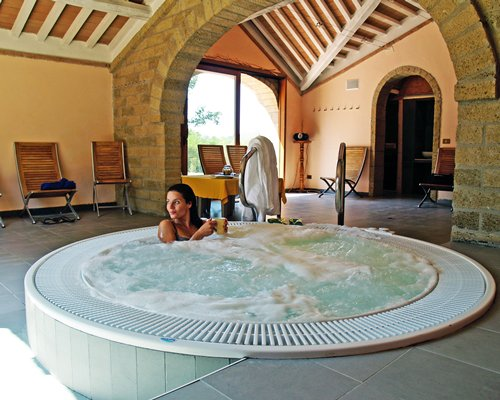 A woman enjoying in an indoor hot tub.