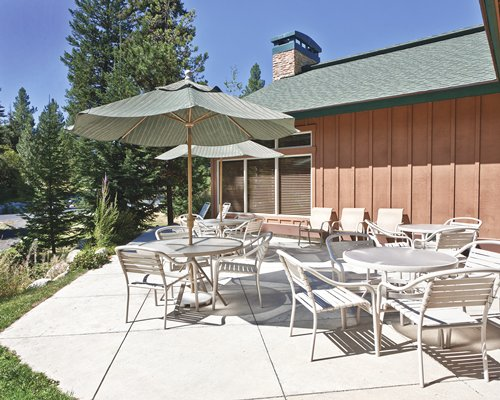 Outdoor patio with patio furniture and sunshades.