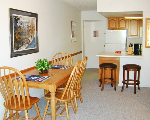 An open plan kitchen with breakfast bar and dining area.
