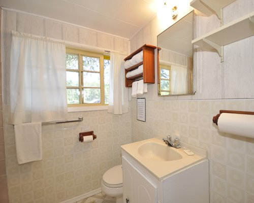 A bathroom with a closed sink vanity.