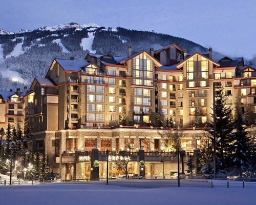Exterior view of Raintree's Whiski Jack at The Westin Resort and Spa Whistler at night during winter.