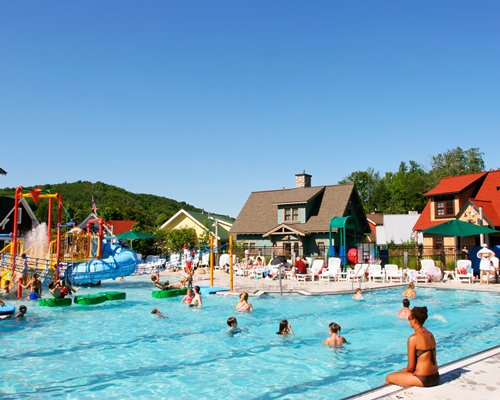 A view of kids in an outdoor kiddie pool alongside the resort.