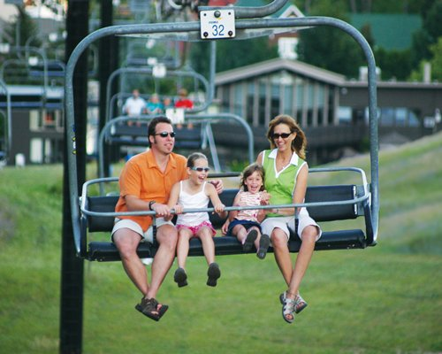 A family travelling on a ski lift.