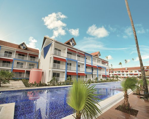 Scenic exterior view of multiple unit balconies with outdoor swimming pool.
