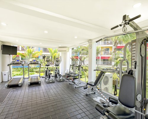 A well equipped fitness center with outside view.