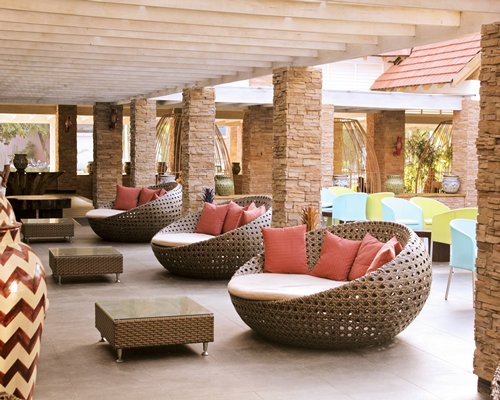 An outdoor lounge area alongside the resort units.