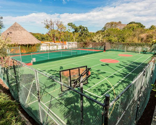 Outdoor recreation area with a basketball court and tennis court.