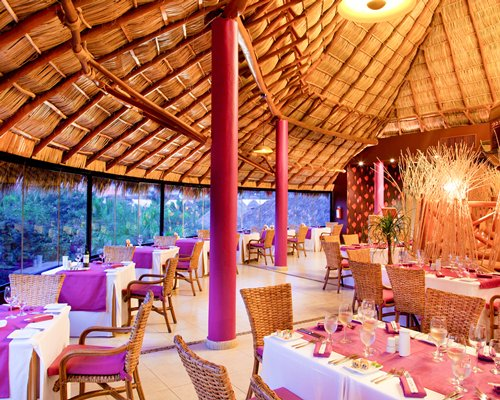 Restaurant at Grand Palladium Vallarta with outside view.