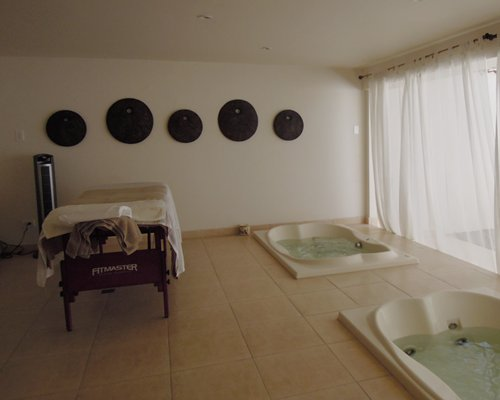 A well furnished indoor spa room.