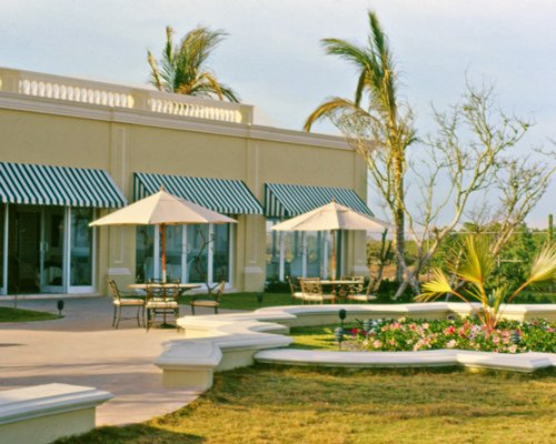 Scenic exterior view of resort units with an outdoor dining area.