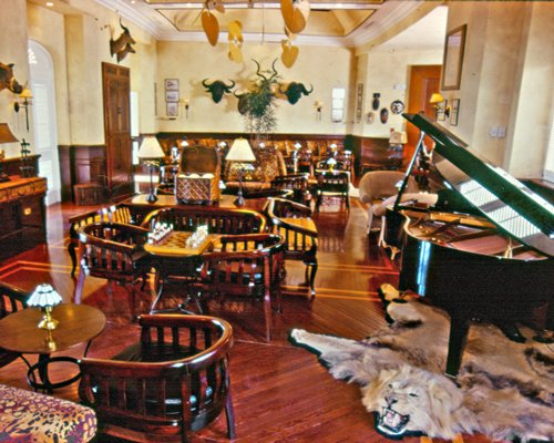 A well furnished indoor restaurant with a piano.