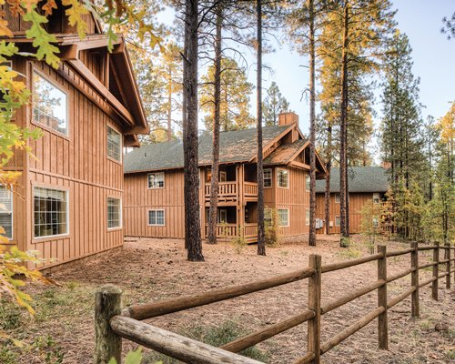 Exterior view of the WorldMark Pinetop resort alongside the wooden fence.