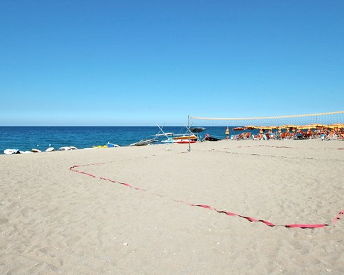 A view of beach volleyball court alongside the beach.