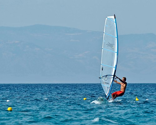 A man windsurfing.