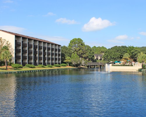 An exterior view of the Island Club IV resort with the waterfront.