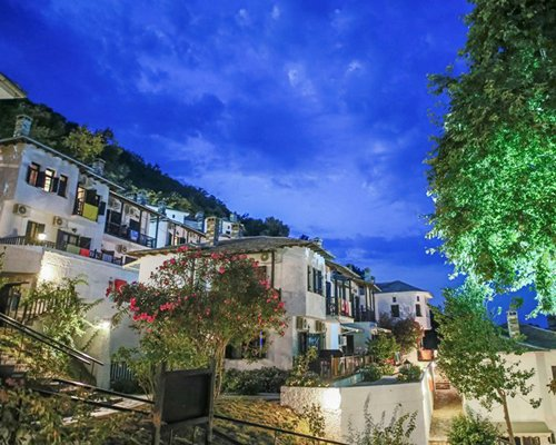 Exterior view of Pilio Holiday Club at dusk.